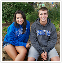 Female and male student in Creighton gear
